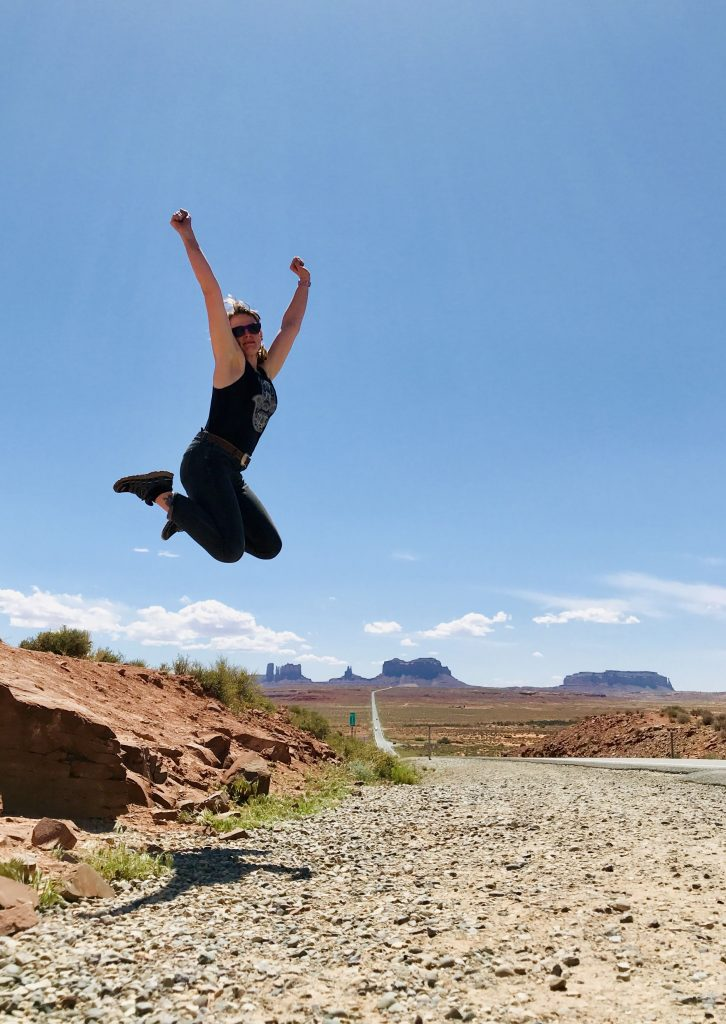 Get outdoors get happy jumping monument valley